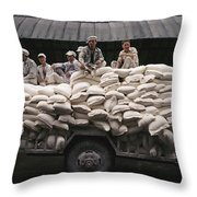 Men Sit On Bags Of Flour Throw Pillow by Justin Guariglia