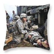 Pararescuemen Prepare To Transport Throw Pillow by Stocktrek Images