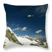 Person Dangles From A Helicopter Throw Pillow by Michael Melford