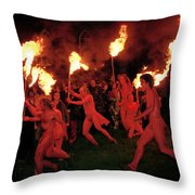 Red-painted Revelers Throw Pillow by Jim Richardson