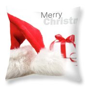 Santa hat and gift with red bow Throw Pillow by Sandra Cunningham