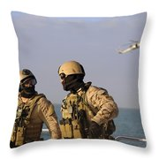Seals Aboard A Rigid-hull Inflatable Throw Pillow by Stocktrek Images