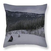 Snowmobilers In Yellowstone National Throw Pillow by Raymond Gehman