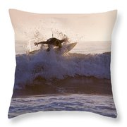 Surfer At Dusk Riding A Wave At Rincon Throw Pillow by Rich Reid