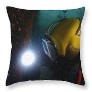 U.s. Navy Diver Welds A Repair Patch Throw Pillow by Stocktrek Images