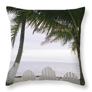 White Beach Chairs Line The Shore Throw Pillow by Stephen Alvarez