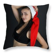 Young Woman Wearing Santa Hat Throw Pillow by Ilan Rosen