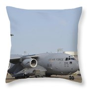 A C-17 Globemaster Iii Parked Throw Pillow by Stocktrek Images