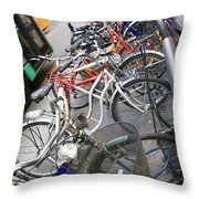 Many Bikes Throw Pillow by Marilyn Hunt