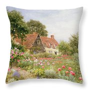 A Cottage Garden Throw Pillow by Henry Sutton Palmer