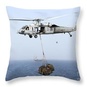 A Mh-60 Helicopter Transfers Cargo Throw Pillow by Gert Kromhout