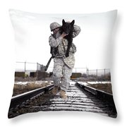 A Military Dog Handler Uses An Throw Pillow by Stocktrek Images