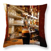 A Pint Of Dark Beer Sits In A Pub Throw Pillow by Jim Richardson