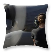 A Soldier Monitors The Performance Throw Pillow by Stocktrek Images