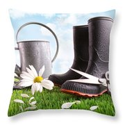 Boots With Watering Can And Daisy In Grass  Throw Pillow by Sandra Cunningham