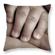 Closeup Of A Baby's Hand Throw Pillow by Oleksiy Maksymenko