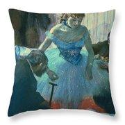 Dancer In Her Dressing Room Throw Pillow by Edgar Degas
