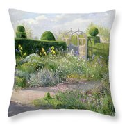 Irises In The Herb Garden Throw Pillow by Timothy Easton