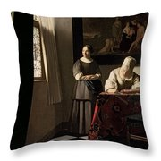 Lady Writing A Letter With Her Maid Throw Pillow by Jan Vermeer