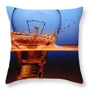 light bulb and splash water Throw Pillow by Setsiri Silapasuwanchai