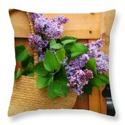 Lilacs In A Straw Purse Throw Pillow by Sandra Cunningham
