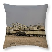 M1 Abrams Tanks At Camp Warhorse Throw Pillow by Terry Moore