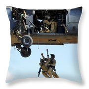Pararescuemen Are Hoisted Into An Hh-60 Throw Pillow by Stocktrek Images