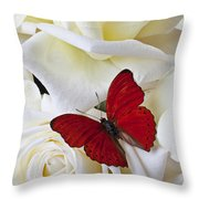 Red butterfly on white roses Throw Pillow by Garry Gay