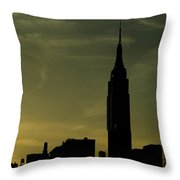 Silhouette Of Empire State Building Throw Pillow by Todd Gipstein