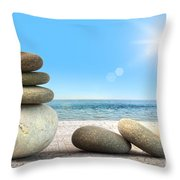 Stack of spa rocks on wood against blue sky Throw Pillow by Sandra Cunningham