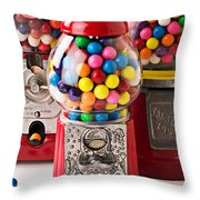 Three Bubble Gum Machines Throw Pillow by Garry Gay