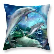 Three Dolphins Throw Pillow by Carol Cavalaris