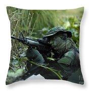 U.s. Navy Seal Crosses Through A Stream Throw Pillow by Tom Weber