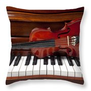 Violin On Piano Throw Pillow by Garry Gay