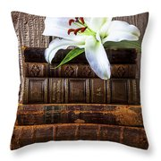 White Lily On Antique Books Throw Pillow by Garry Gay