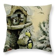 Winter Bird Table With Blue Tits Throw Pillow by Carl Donner
