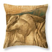 Woman At Her Toilet Throw Pillow by Edgar Degas