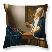 Woman Holding a Balance Throw Pillow by Jan Vermeer