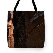 A glimpse of Al Khazneh from the Siq in Petra Jordan Tote Bag by Robert Preston