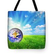 Earth Globe On Green Grass Tote Bag by Michal Bednarek