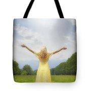 girl on meadow Tote Bag by Joana Kruse