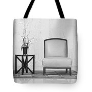 A Chair And A Table With A Plant Tote Bag by Rudy Umans