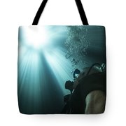 A Scuba Diver Surfacing And Looking Tote Bag by Michael Wood