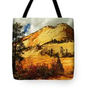 A Tree And Orange Hill Tote Bag by Jeff Swan