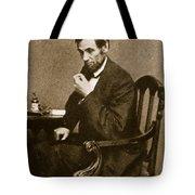 Abraham Lincoln Sitting at Desk Tote Bag by Mathew Brady