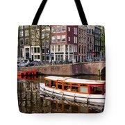 Amsterdam Canal And Houses Tote Bag by Artur Bogacki