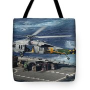 An Mh-60s Sea Hawk Helicopter Picks Tote Bag by Stocktrek Images