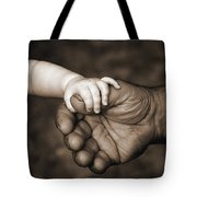 Babys Hand Holding On To Adult Hand Tote Bag by Corey Hochachka
