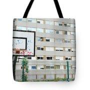Basketball Court In A Social Neighbourhood Tote Bag by Luis Alvarenga