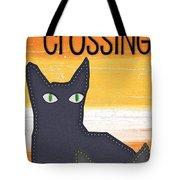 Black Cat Crossing Tote Bag by Linda Woods